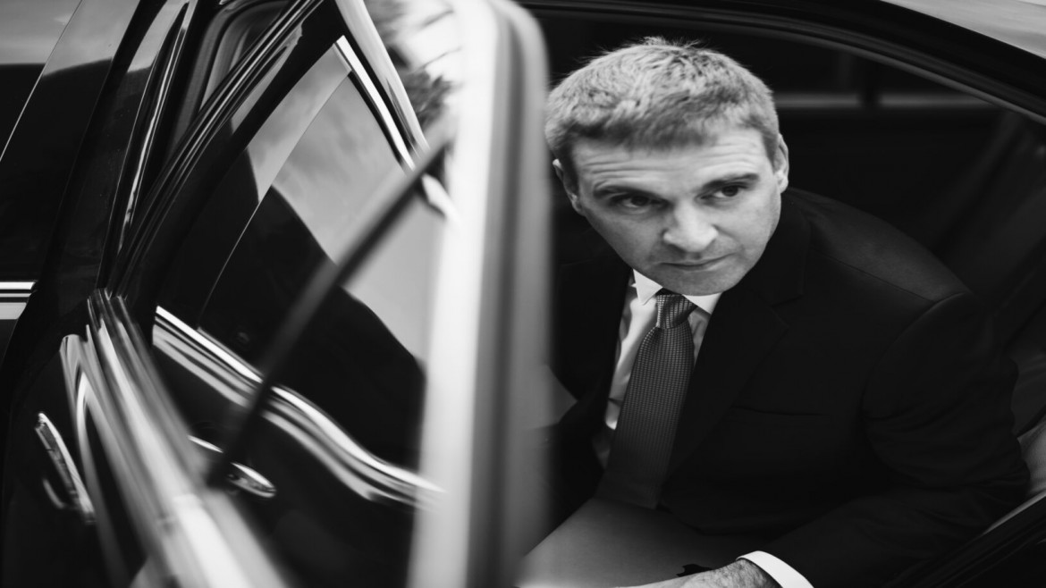 Businessman getting out of his car